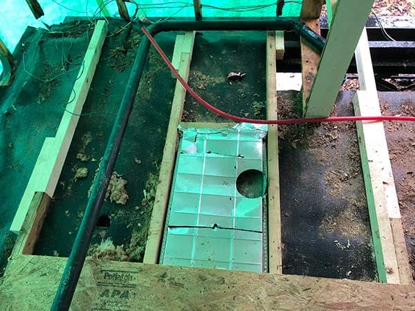 Section of rear trailer floor with subfloor removed. Some floor support boards have been replaced.
