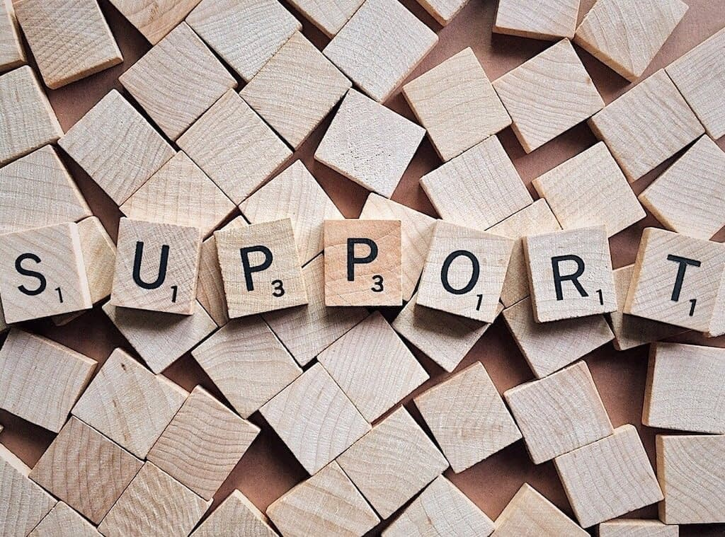 Support spelled in Scrabble letters