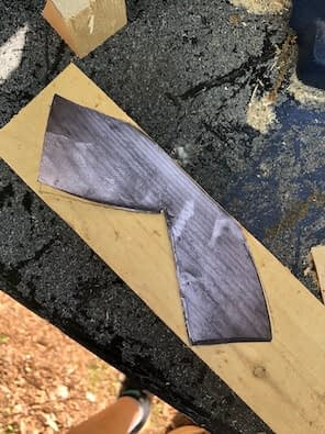 black and white shape on top of piece of wood